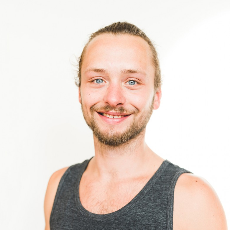 Chag smiling and showing off his big blue eyes during headshot at ashtanga yoga victoria photoshoot