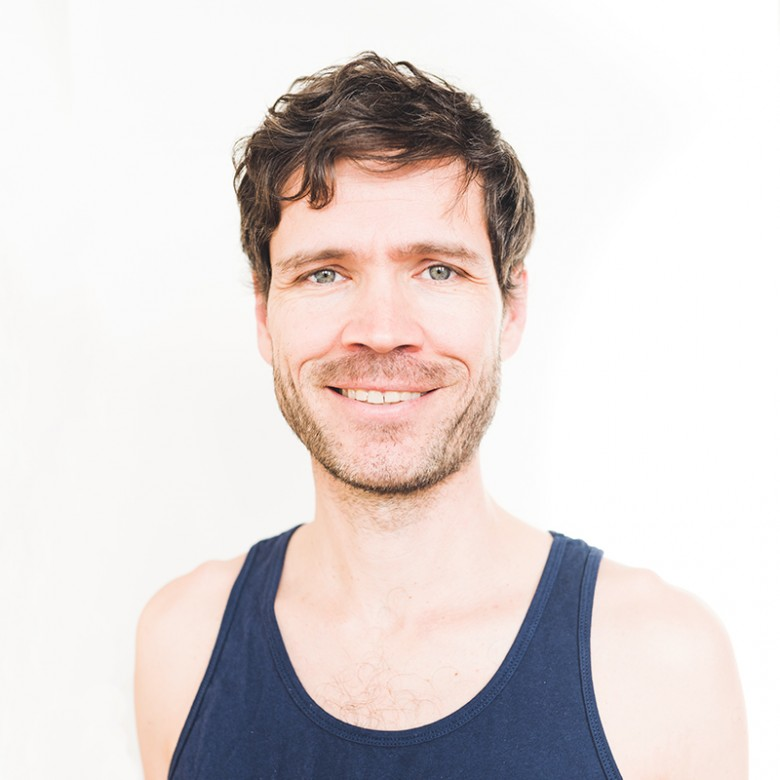 Richard Moody smiling with blue shirt on for headshot at ashtanga yoga victoria photoshoot