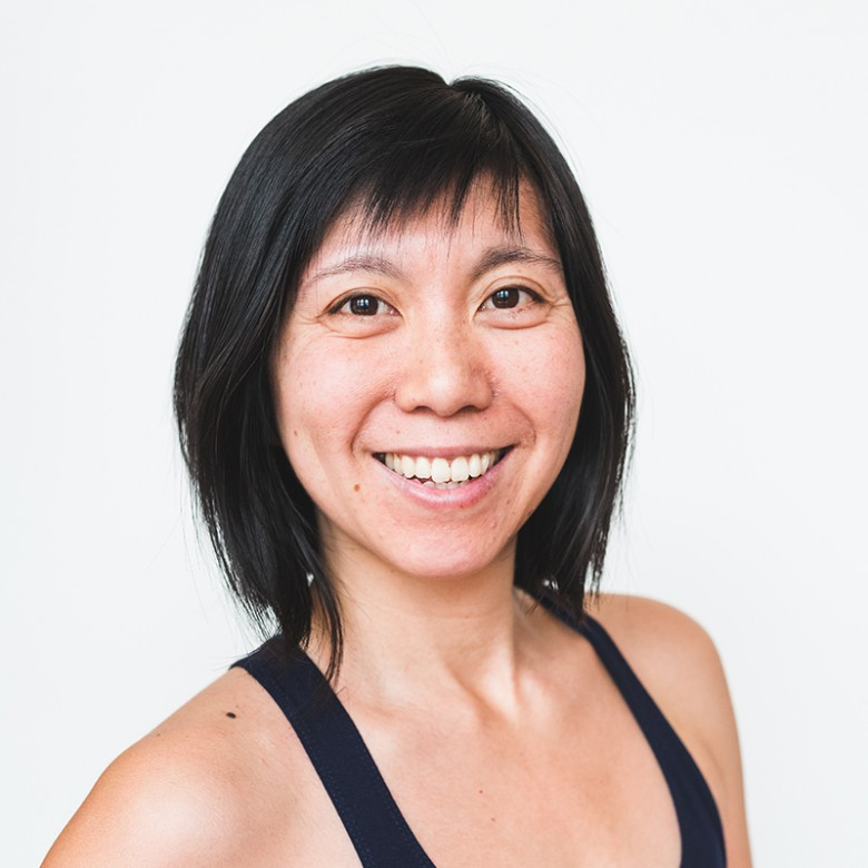 Sachiko walton smiling with black Ashtanga yoga victoria tank top for headshot at ashtanga yoga victoria photoshoot